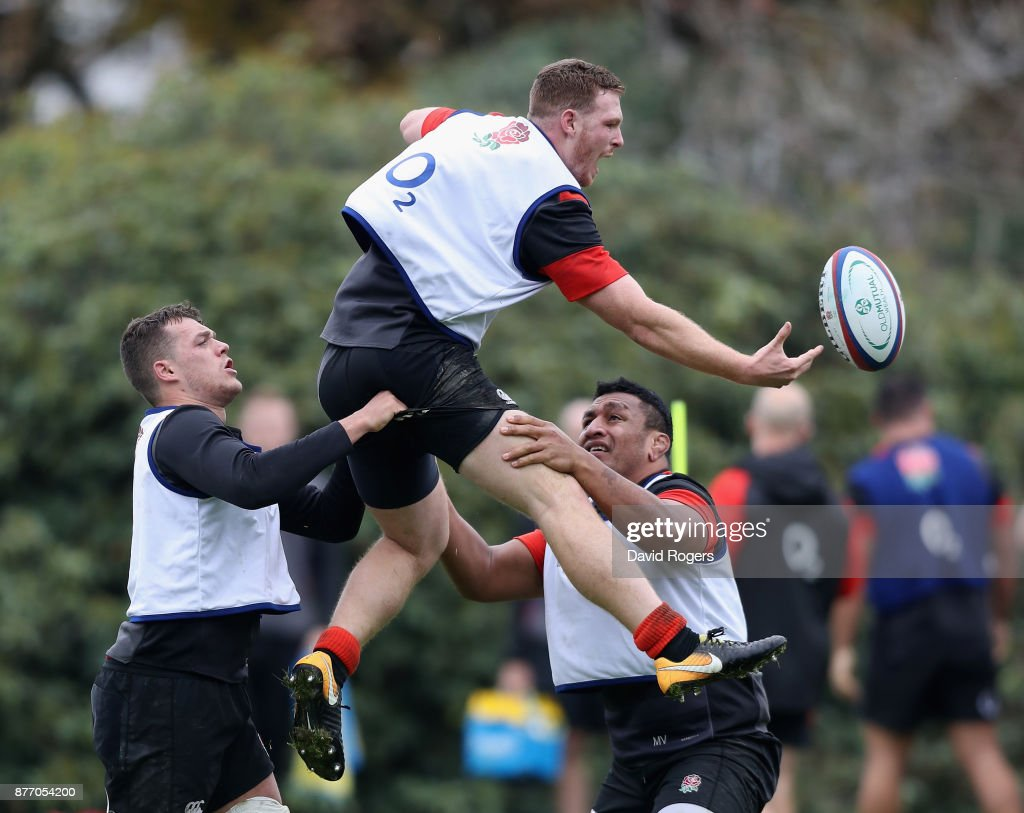 Sam Simmonds attempts to catch the ball as Zach Mercer (L) and Mako Vunipola assist during the England training session held at Pennyhill Park on November 21, 2017 in Bagshot, England.