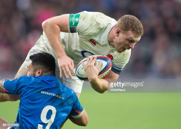 Sam Simmonds of England is tackled by Dwayne Polataivao of Samoa during the Old Mutual Wealth Series autumn international match between England and...
