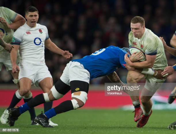 Sam Simmonds of England is tackled by Fa'atiga Lemalu of Samoa during the Old Mutual Wealth Series autumn international match between England and...