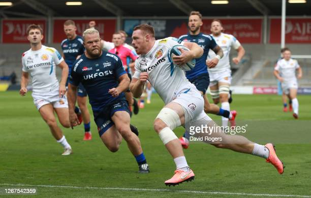 Sam Simmonds of Exeter Chiefs breaks clear to score the first try during the Gallagher Premiership Rugby match between Sale Sharks and Exeter Chiefs...