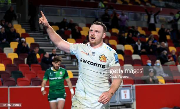 Sam Simmonds of Exeter Chiefs celebrates after scoring his third try during the Gallagher Premiership Rugby match between London Irish and Exeter...
