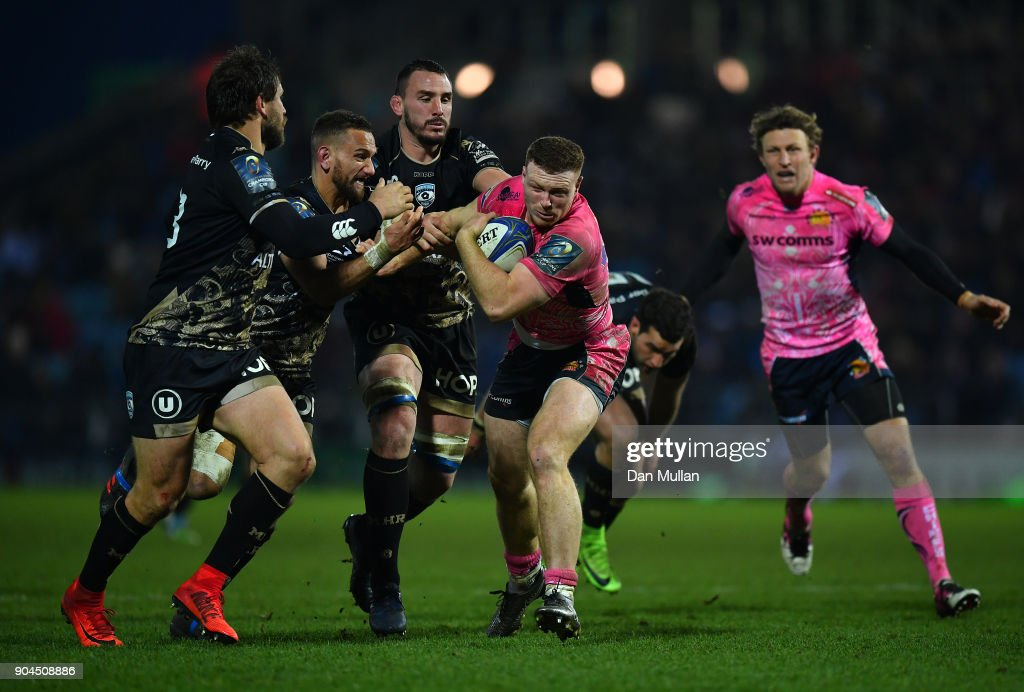 Sam Simmonds of Exeter Chiefs is tackled by Aaron Cruden and Louis Picamoles of Montpellier during the European Rugby Champions Cup match between Exeter Chiefs and Montpellier at Sandy Park on January 13, 2018 in Exeter, England.