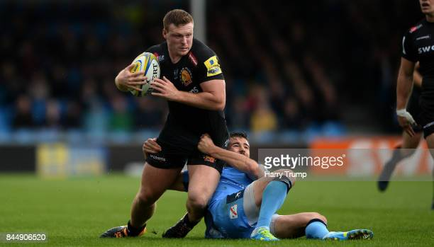 Sam Simmonds of Exeter Chiefs is tackled by Tommy Bell of London Irish during the Aviva Premiership match between Exeter Chiefs and London Irish at...