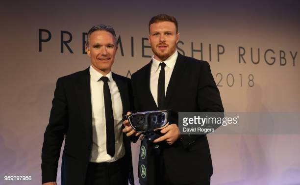 Sam Simmonds of Exeter Chiefs receives the Land Rover Discovery of the Season award from Scott Dicken of Jaguar Land Rover during the Premiership...