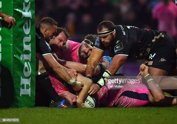 Sam Simmonds of Exeter Chiefs stretches out to score his side's second try during the European Rugby Champions Cup match between Exeter Chiefs and...