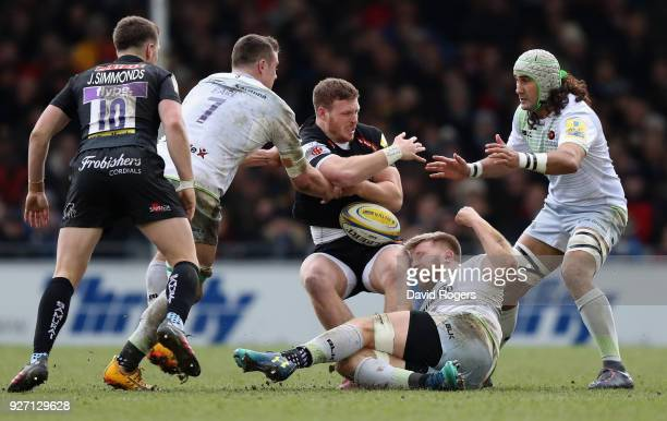 Sam Simmonds of Exeter is held by Ben Earl Dominic Day and Blair Cowan during the Aviva Premiership match between Exeter Chiefs and Saracens at Sandy...