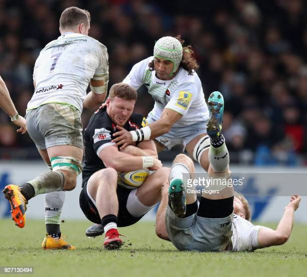 Sam Simmonds of Exeter is held by Ben Earl Jackson Wray and Blair Cowan during the Aviva Premiership match between Exeter Chiefs and Saracens at...