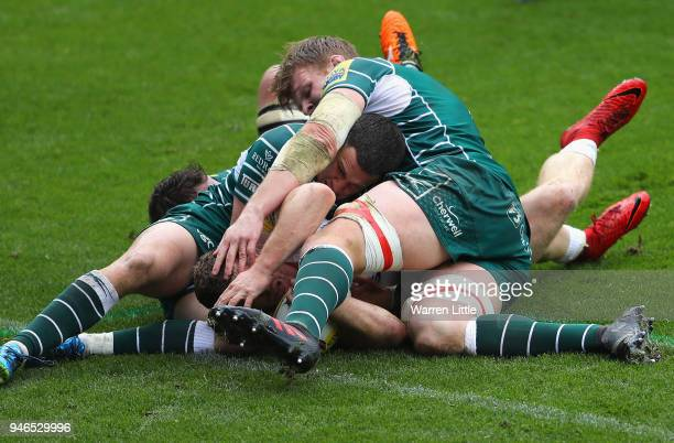 Sam Simmons of Exeter Chiefs flights his way over the try line to score during the Aviva Premiership match between London Irish and Exeter Chiefs at...