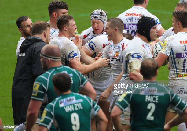 Sam Simmons of Exeter Chiefs is congratulated by his team mates after scoring a try during the Aviva Premiership match between London Irish and...