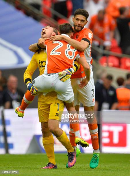 Sam Slocombe Jack Payne and Kelvin Mellor of Blackpool celebrate victory and promotion after the Sky Bet League Two Playoff Final between Blackpool...