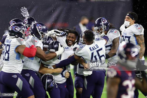 Sam Sloman of the Tennessee Titans celebrates a field goal to win the game against the Houston Texans at NRG Stadium on January 03, 2021 in Houston,...
