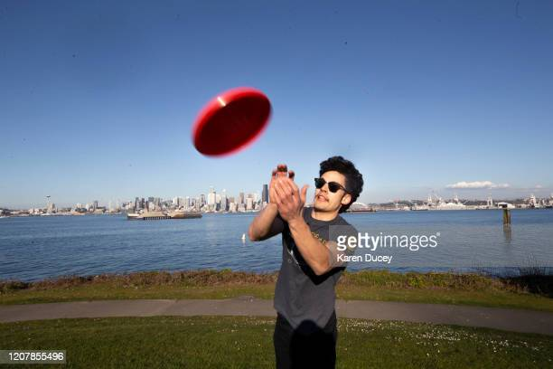 Sam Slutskey plays frisbee with his girlfriend at a park in West Seattle on March 20 2020 in Seattle Washington Governor Jay Inslee strongly...