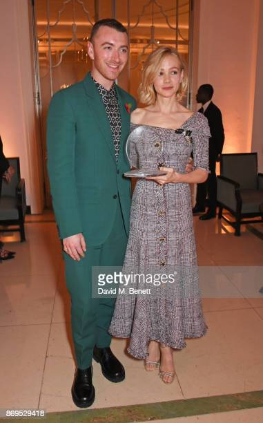 Sam Smith and Carey Mulligan winner of the Philanthropist Award attend Harper's Bazaar Women of the Year Awards in association with Ralph Russo...