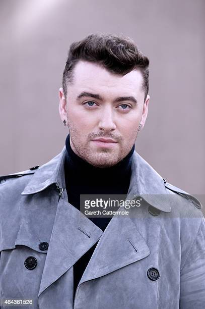 Sam Smith attends the Burberry Prorsum show during London Fashion Week Fall/Winter 2015/16 at Perk's Field on February 23 2015 in London England