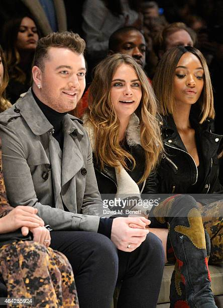 Sam Smith, Cara Delevingne and Jourdan Dunn attend the Burberry Prorsum AW 2015 show during London Fashion Week at Kensington Gardens on February 23,...