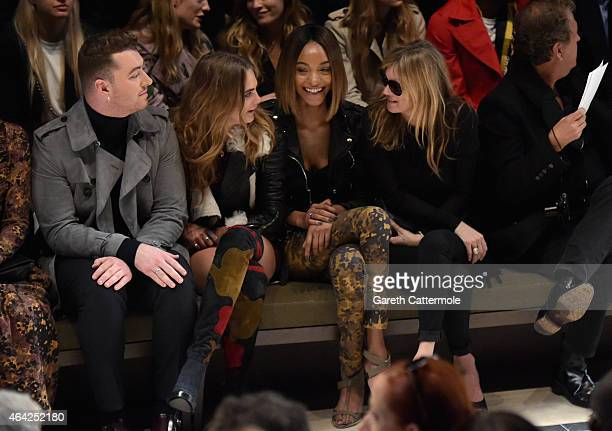 Sam Smith, Cara Delevingne, Jourdan Dunn and Kate Moss attend the Burberry Prorsum AW 2015 show during London Fashion Week at Kensington Gardens on...