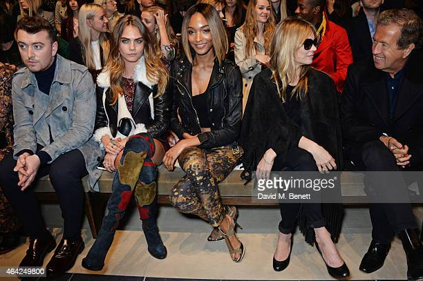 Sam Smith, Cara Delevingne, Jourdan Dunn, Kate Moss and Mario Testino attend the Burberry Prorsum AW 2015 show during London Fashion Week at...
