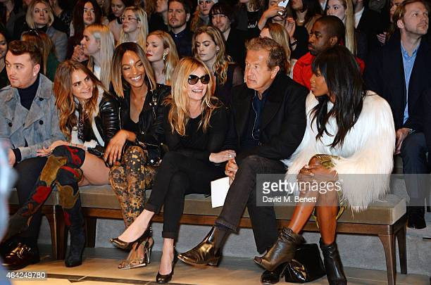 Sam Smith Cara Delevingne Jourdan Dunn Kate Moss Mario Testino and Naomi Campbell attend the Burberry Prorsum AW 2015 show during London Fashion Week...