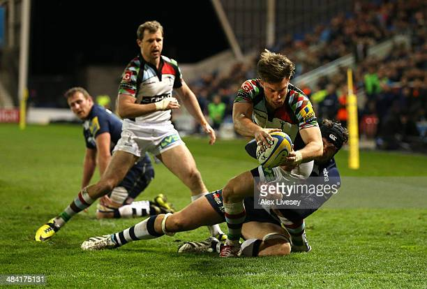 Sam Smith of Harlequins beats a tackle from Andrei Ostrikov of Sale Sharks to score a try during the Aviva Premiership match between Sale Sharks and...