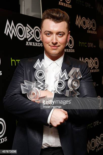 Sam Smith poses with his awards for Best RB and Soul Best Song Best Album and Best Male Act in the winners room at the MOBO Awards at SSE Arena on...