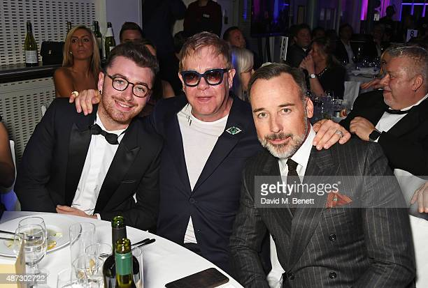 Sam Smith Sir Elton John and David Furnish attend the GQ Men Of The Year Awards at The Royal Opera House on September 8 2015 in London England