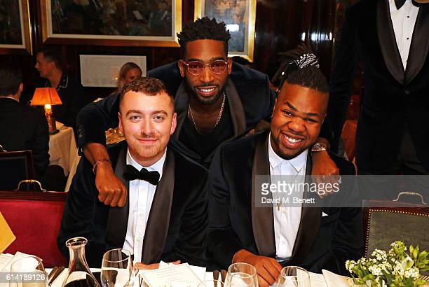 Sam Smith Tinie Tempah and MNEK attend the launch of the Annabel's Smoking Jacket by Casely Hayford at Annabel's on October 12 2016 in London England