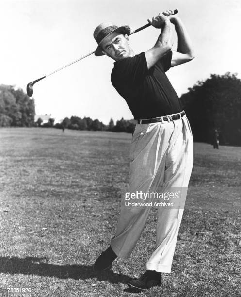 Sam Snead at the end of a golf swing c 1950