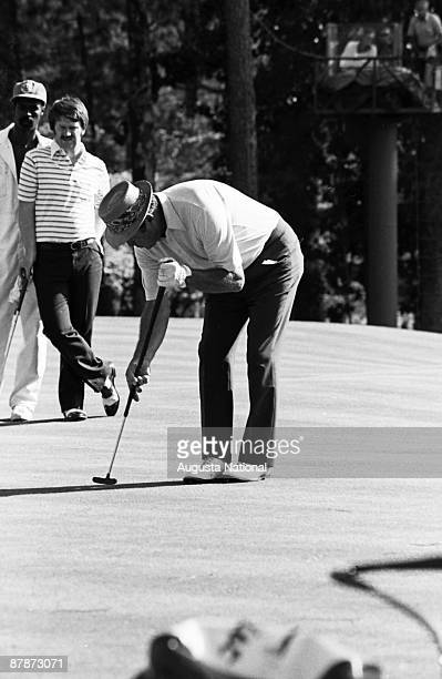 Sam Snead displays his unusal putting style while Peter McEnvoy watches with his caddie during the 1980 Masters Tournament at Augusta National Golf...
