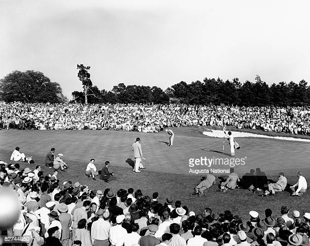 Sam Snead putts in front of a gallery of patrons to win the 1949 Masters Tournament at Augusta National Golf Club held April 7-10, 1949 in Augusta,...