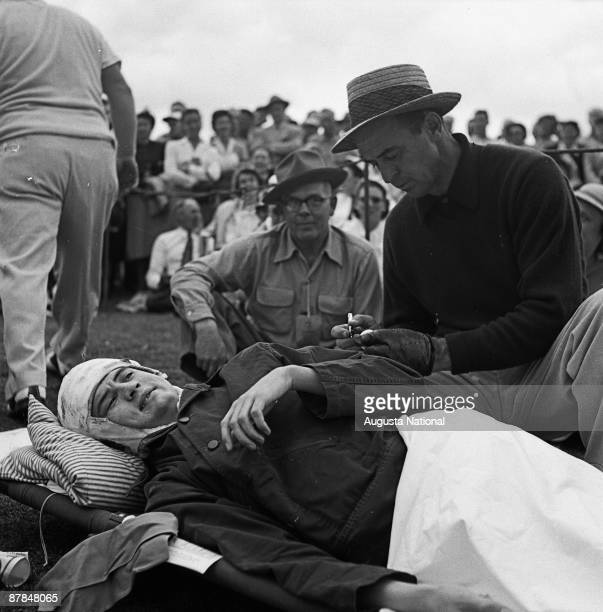 Sam Snead signs autographs for wounded soldiers during the 1952 Masters Tournament at Augusta National Golf Club in April 1952 in Augusta Georgia
