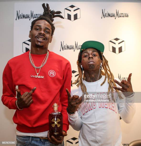 DJ Sam Sneak and Lil Wayne at The Young Money Merch capsule celebration at Neiman Marcus Bal Harbour on March 16 2018 in Bal Harbour Florida