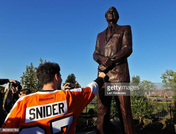 Sam Snider touches the Stanley Cup ring on the statue of his late Father Ed Snider Owner and Founder of the Philadelphia Flyers during an afternoon...