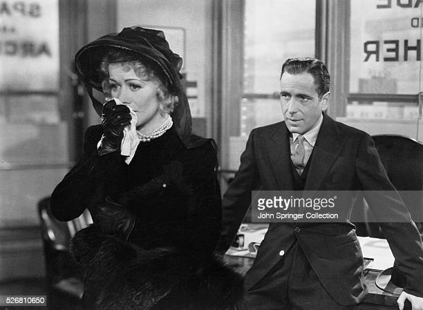 Sam Spade talks with the widow of his late partner Miles Archer in The Maltese Falcon Motion pictured released in 1941 | Version of 'The Maltese...