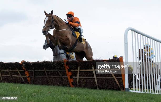 Sam Spinner ridden by Joe Colliver jumps a fence to during the Betfair Stayers' Handicap Hurdle on November 25 2017 in Haydock England