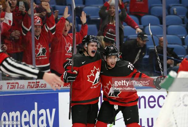 Sam Steel of Canada celebrates his goal against Finland with Jordan Kyrou during the first period at KeyBank Center on December 26 2017 in Buffalo...