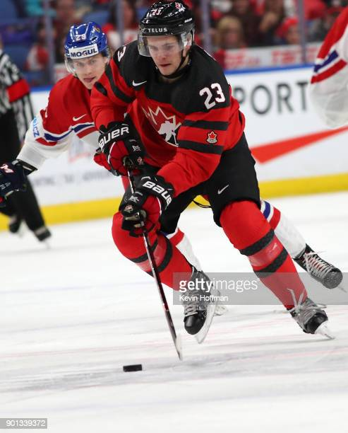 Sam Steel of Canada skates up ice with the puck as Albert Michnac of Czech Republic pursues in the first period during the IIHF World Junior...