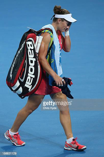 Sam Stosur of Australia leaves the court after losing her match against Sofia Arvidsson of Sweden during day two of the Brisbane International at Pat...