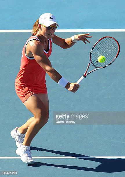 Sam Stosur of Australia plays a backhand volley in her singles match against Anabel MedinaGarrigues of Spain during the 2010 Fed Cup World Group II...