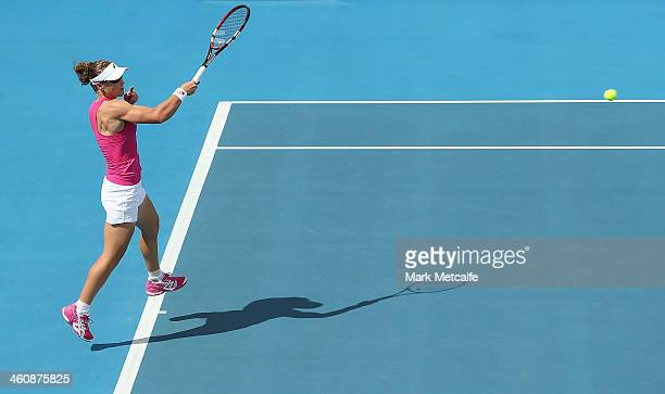 Sam Stosur of Australia plays a forehand in her first round match against Madison Brengle of the USA during day two of the Moorilla Hobart...