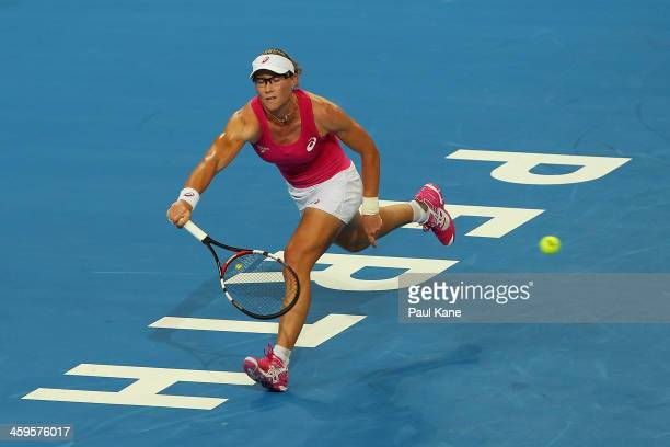 Sam Stosur of Australia plays a forehand to Eugenie Bouchard of Canada in the women's singles match during day one of the 2014 Hopman Cup at Perth...