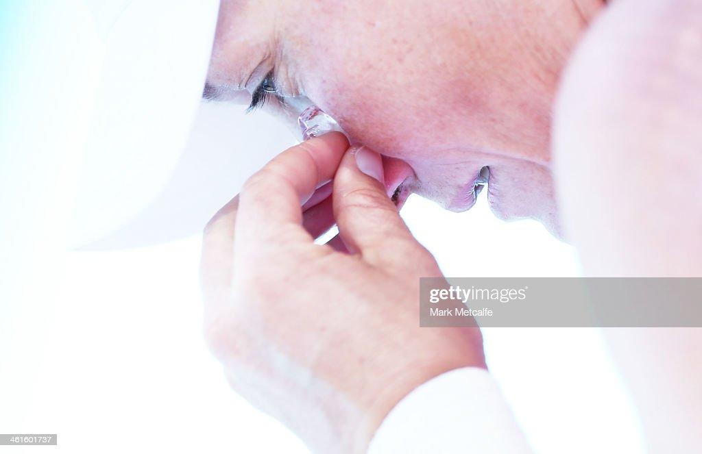 Sam Stosur of Australia receives treatment for a nose bleed before the start of her semi final match against Klara Zakopalova of the Czech Republic during day six of the Moorilla Hobart International at Domain Tennis Centre on January 10, 2014 in Hobart, Australia.