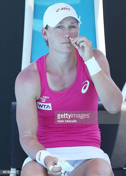 Sam Stosur of Australia receives treatment for a nose bleed before the start of her semi final match against Klara Zakopalova of the Czech Republic...
