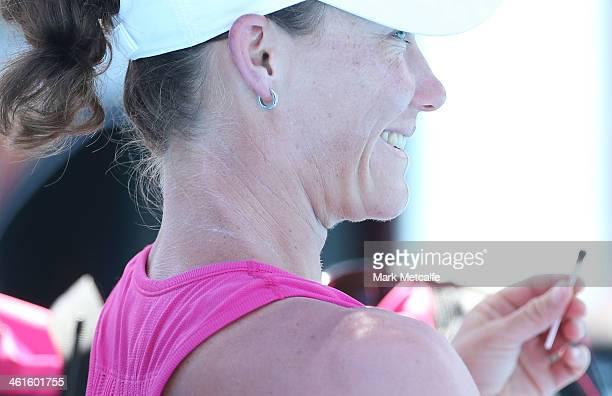 Sam Stosur of Australia smiles as she receives treatment for a nose bleed before the start of her semi final match against Klara Zakopalova of the...