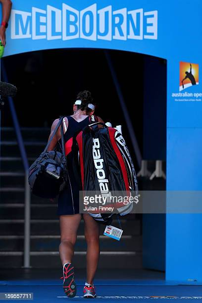 Sam Stosur of Australia walks off court after losing her second round match against Jie Zheng of China during day three of the 2013 Australian Open...