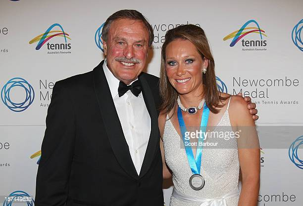 Sam Stosur poses with John Newcombe after she won the Newcombe Medal during the 2012 John Newcombe Medal at Crown Palladium on December 3 2012 in...