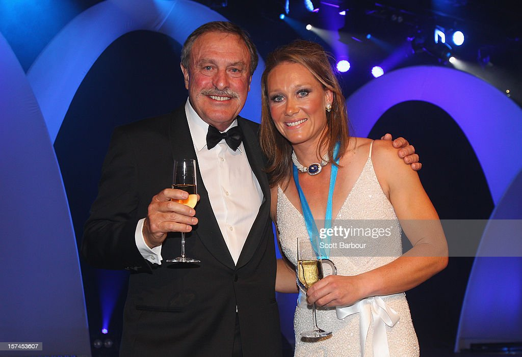Sam Stosur poses with John Newcombe after she won the Newcombe Medal during the 2012 John Newcombe Medal at Crown Palladium on December 3, 2012 in Melbourne, Australia.