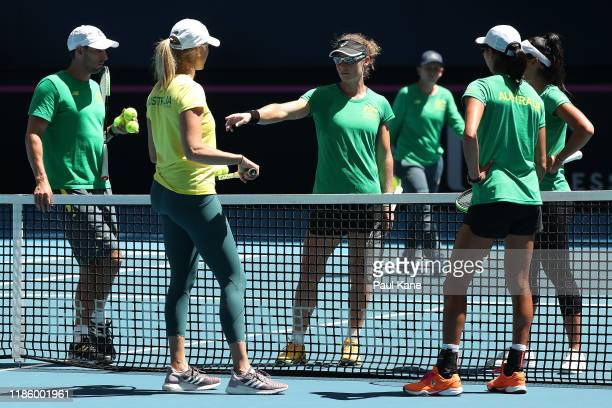 Sam Stosur talks with Alicia Molik Australia Fed Cup Captain Andrew Roberts Astra Sharma and Priscilla Hon of Australia while practicing during the...