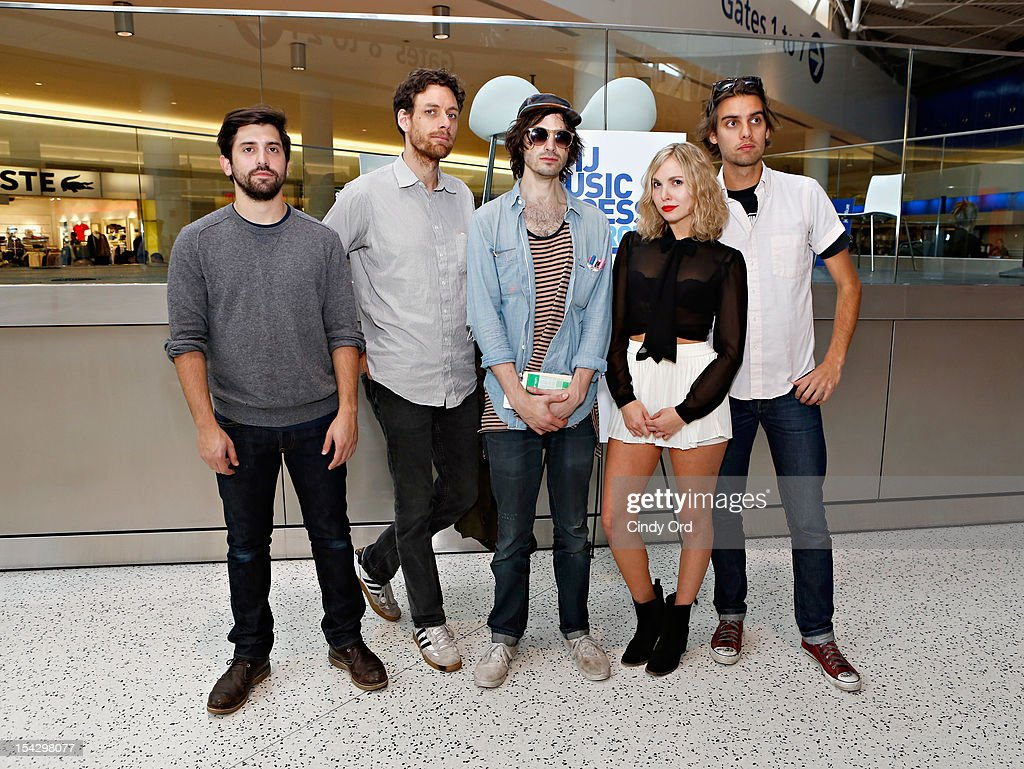 Sam Sugarman, Jason Boesel, Alex Greenwald, Z Berg and Michael Runion of JJAMZ pose prior to performing at JetBlue's Live From T5 Concert Series - CMJ Music Access Live at John F. Kennedy International Airport on October 17, 2012 in New York City.