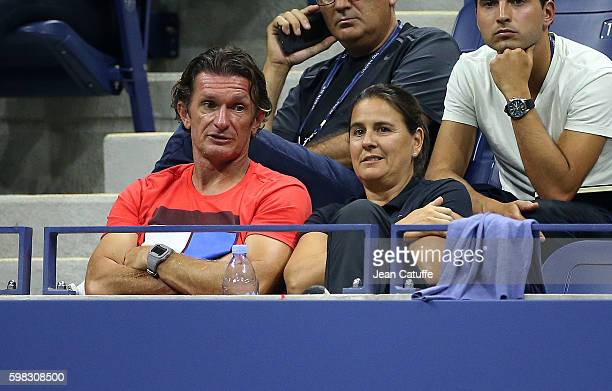 Sam Sumyk, coach of Garbine Muguruza of Spain and Conchita Martinez look on during her second round match on day 3 of the 2016 US Open at USTA Billie...