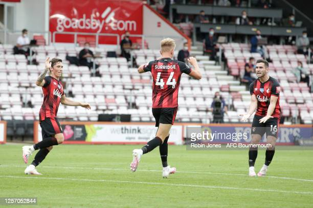 Sam Surridge clelebrates with teammates Harry Wilson and Lewis Cook of Bournemouth but his goal is ruled out by VAR during the Premier League match...